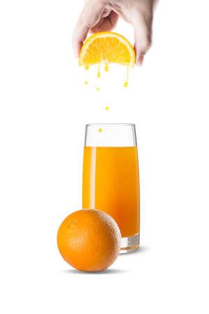 squeeze: Hand Squeeze Orange Slice With Orange Juice Droplets