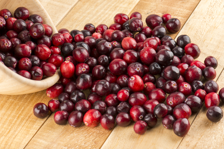 cranberries: Fresh Cranberries On Wood Table