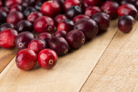 cranberries: Cranberries On Wood Table