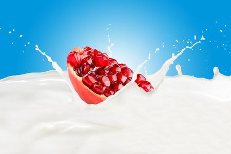 Fresh Pomegranate With Milk Splash Imagens