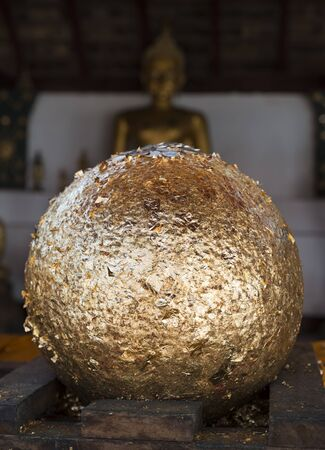 patching: golden ball from gold leaves patching in Buddhist temple