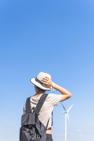 wind farm: young girl lose the way at wind farm