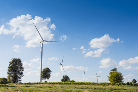 windfarm: wind turbines for genertating electricity with blue sky Stock Photo