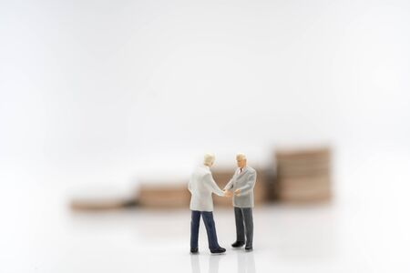 Miniature toy: Business man discussing about business  , business ,financial, Success, Business Growth concept. Stock Photo