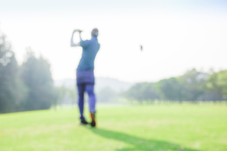 blur photograpy golf player during hit golf ball at beautifull tropical golf course .Healthy exercise golf game concept.