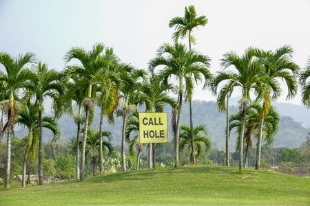 beautifull tropical golf course call hole plate on palm tree.Healthy exercise golf game concept. Archivio Fotografico - 108168306