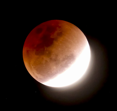 Blur photography, Red lunar eclipse or full moon on black background.