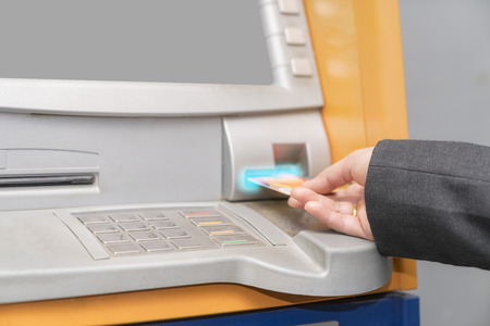 Woman hand used ATM card or credit card for withdraw money from ATM machine.