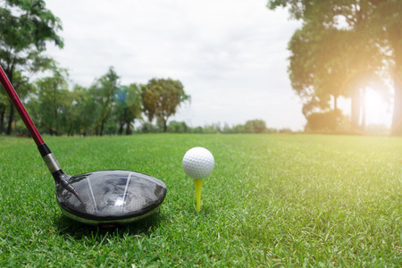 Golf ball and club on green grass .Sport Healthy concept. Archivio Fotografico