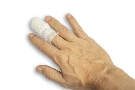 Injured finger with medicine bandage isolated on white background.Accident on finger concept.
