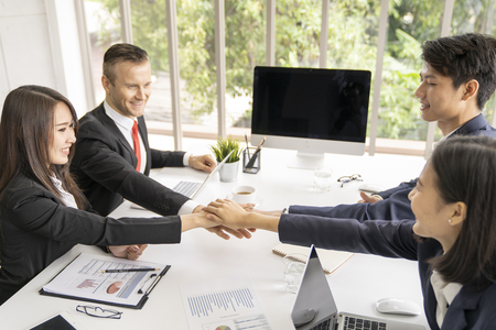 Young business man shaking hands during meeting in office. Success,dealing,greeting ,busisess partner concept.