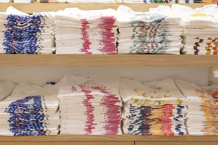 Color full stack of  t-shirt in shopping mall or department store. Archivio Fotografico - 107919688