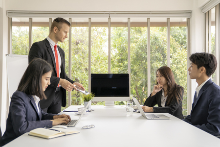 Young business man presented or discuss to client about business project in coference or meeting room. Archivio Fotografico