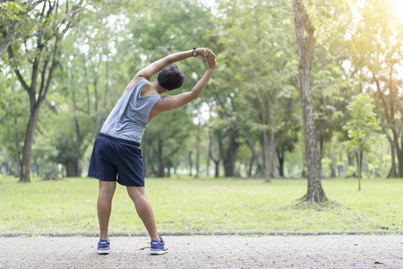 Sporty man jogging or exercise in national park on early morning .Sport concept. Archivio Fotografico - 109630818