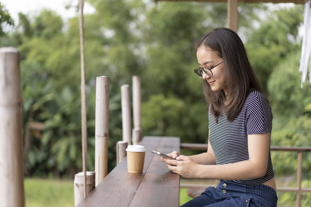 Beautiful young woman used mobile in coffee shop.