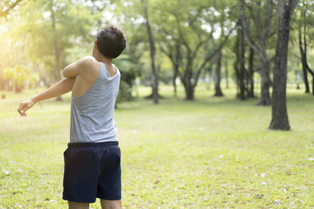 Sporty man jogging or exercise in national park on early morning .Sport concept. Archivio Fotografico