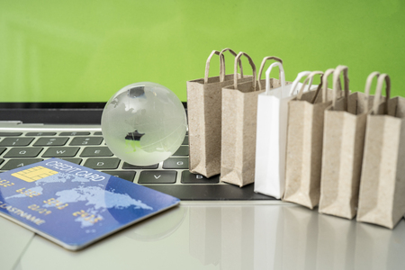 Selling or buying online,shopping online or e-commerce with paper box ,paper bag and credit card in shopping cart or trolley. Archivio Fotografico - 111266335