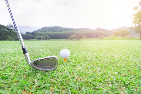 golf ball on green grass ready to hit from t-off in beautifull tropical golf course for background or poster. Archivio Fotografico - 111266342