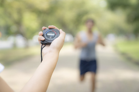 hand holding timer watch for jogging in park. Archivio Fotografico - 111266378