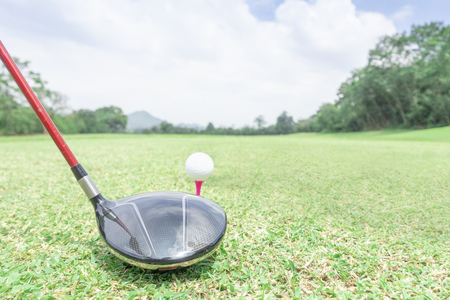golf ball on green grass ready to hit from t-off in beautifull tropical golf course for background or poster. Archivio Fotografico - 111266430