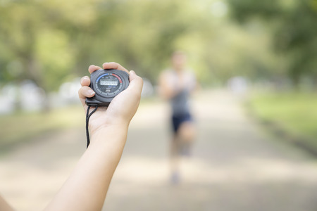 hand holding timer watch for jogging in park. Archivio Fotografico - 111266432