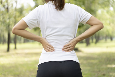 sporty man back pain while exercise in park. Archivio Fotografico - 111266476