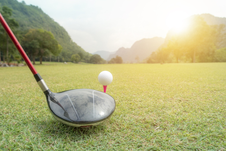 golf ball on green grass ready to hit from t-off in beautifull tropical golf course for background or poster. Archivio Fotografico - 111266487