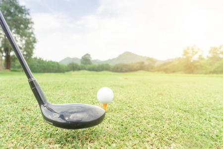 golf ball on green grass ready to hit from t-off in beautifull tropical golf course for background or poster. Archivio Fotografico - 111266498