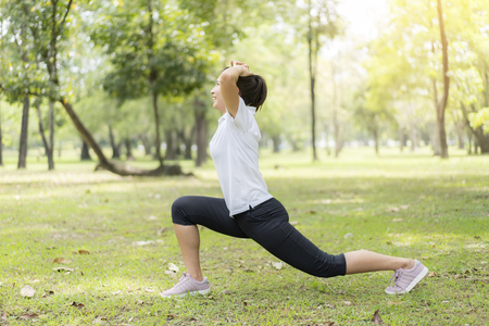 young asian woman jogging or exercise in green park .sporty woman concept. Stock Photo