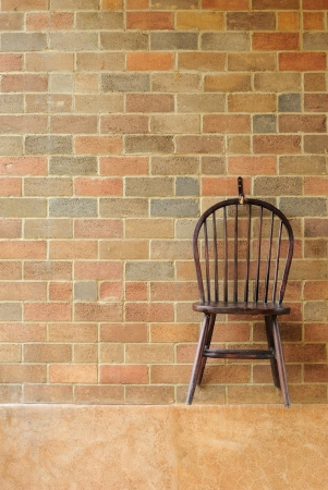 Red brick wall and chair on the wall  photo