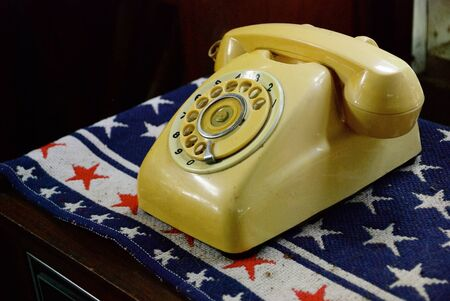 Old telephone with flag