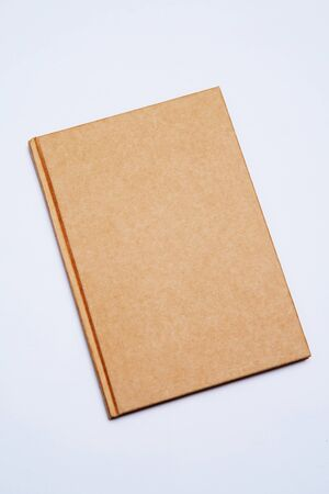 cover old style recycle brown notebook isolated on white backgro Stock Photo