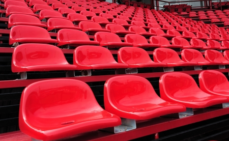 red seats in a stadium photo