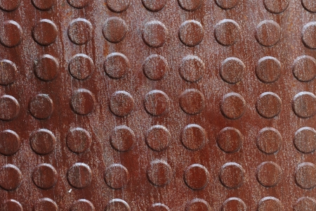 Closeup of rusty metal with knobs Stock Photo