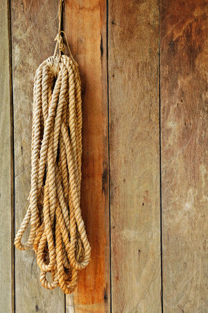 western wall: wood background with rope