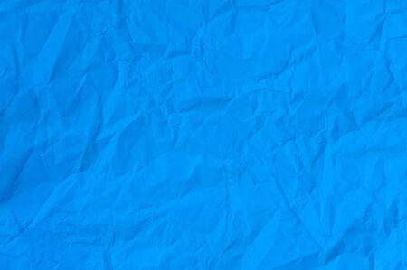 blue paper crumpled