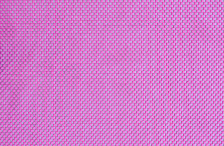 Pink kitchen sponge rubber foam as background texture photo