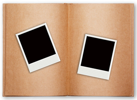 two photo frames with old book open