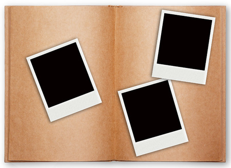 three photo frames with old book open