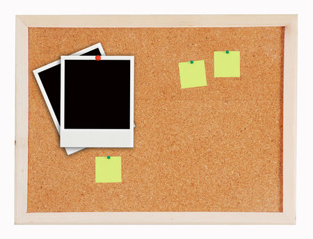 two photo frames and notes on Cork board