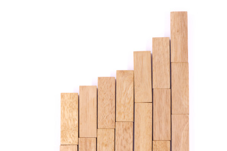 Stock Market Chart with the wood game (jenga). Stock Photo