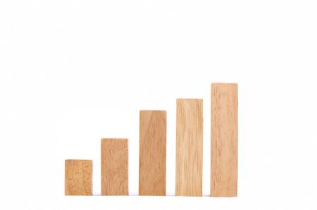 Stock Market Chart with the wood game (jenga) Stock Photo