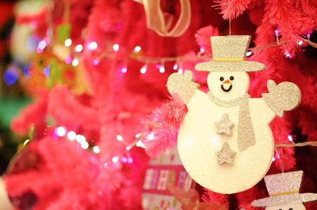 Decorations and snowman on a bright color background