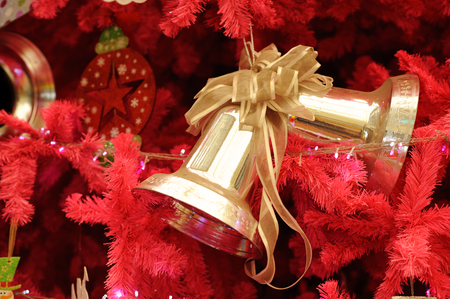 Christmas decorations ring and gold bell Stock Photo