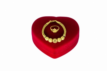 jewry: Gold bracelet and a gold ring in a red heart