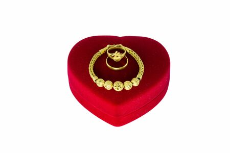 jewry: Gold bracelet and gold ring on the red heart