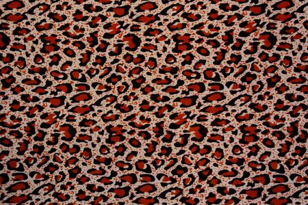 spotted fur: Red and black leopard pattern. Spotted fur animal print as background