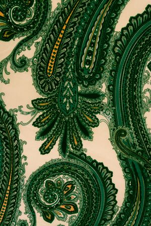 faded: Vintage faded paisley fabric texture