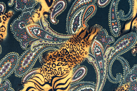 leopard background: texture of print fabric striped leopard and flower for background Stock Photo