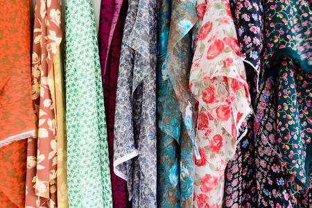 vibrant background: Rolls of colorful fabric as a vibrant background Stock Photo